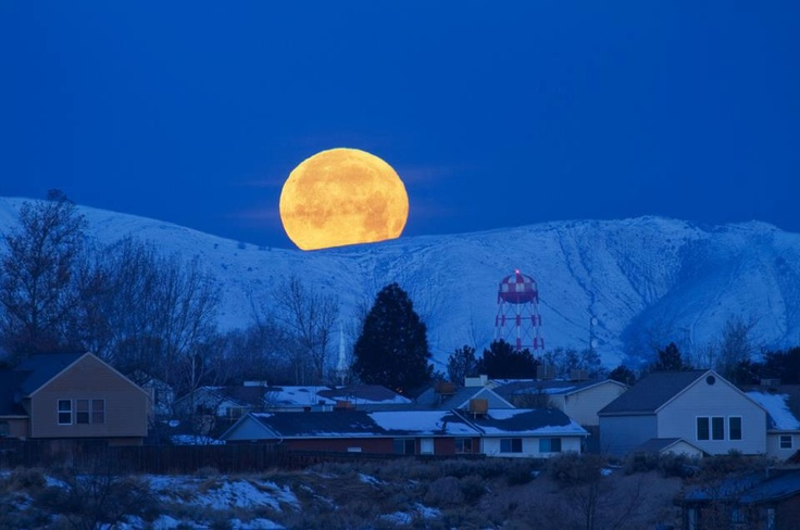 The moon setting over Oquirrh Mountains in the Salt Lake City area. Photo was taken on January 9, 2012 in Kearns, Utah