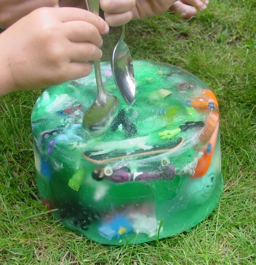 Some hot summer fun: Giant Ice Cube of Fun For Your Little ones.  You could put themed items in there that are a clue to something you might do later in the day (a movie, a trip, etc...) or you could do it on a smaller scale (in a cool whip size container) & hide clues to a treasure hunt where they'll find the next ice block.  It will keep them busy :)