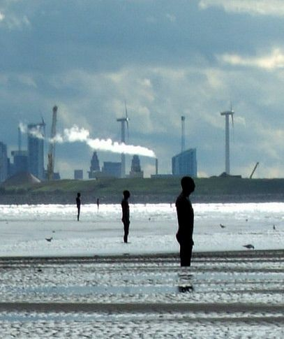 They stand staring out to see, as if they have been left behind - Anthony Gormley's 'Another Place'