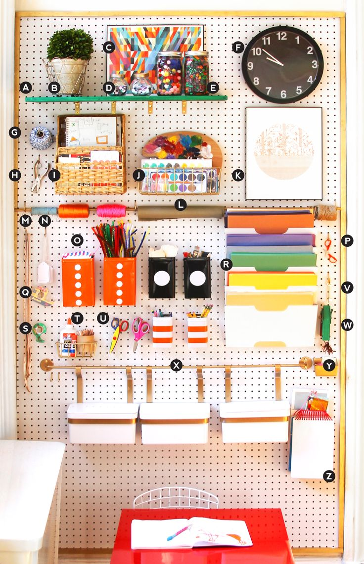 There are so many great ideas on organizing homework spaces to get ready for back to school. We love using a giant pegboard and creating DIY shelves and containers to house all the pretty supplies