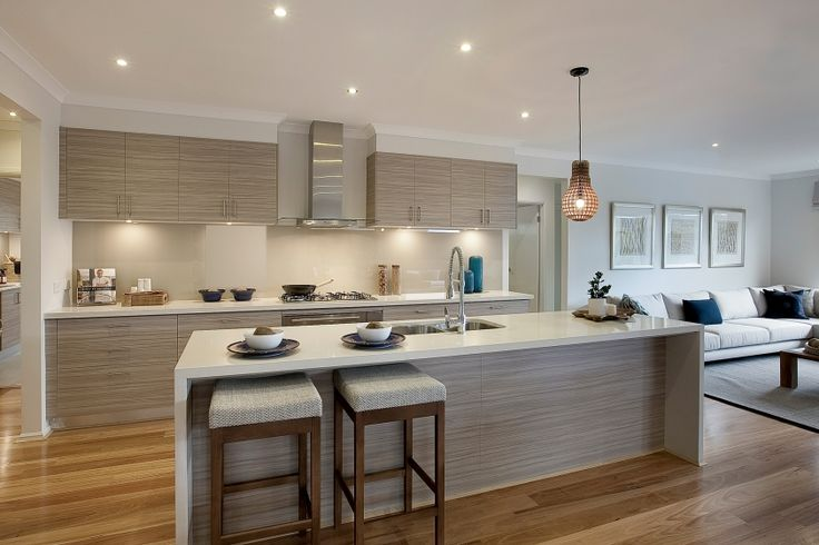 A soft grey and brown palette is used to create the classic beach house look of this kitchen. Grey off wood cabinetry, grey linens and blue hues combine to give a relaxing contemporary feel.