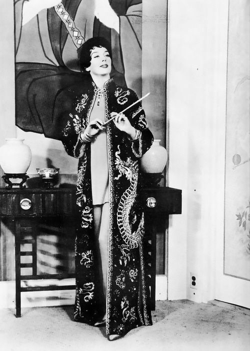 The legendary Rosalind Russell in the role of Mame Dennis in the 1958 movie, Auntie Mame.  Ms. Russell had originated the role in the long running Broadway production of Auntie Mame.