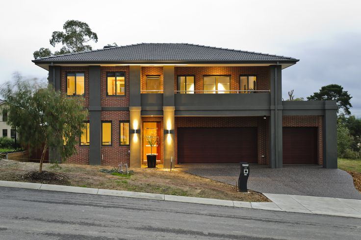 The Range - Custom Designed by Busby Homes. Brick and render façade prior to landscape completion.