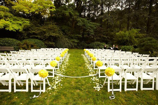 We'll block the aisle with a ribbon before the ceremony, so guests enter from the outside and don't knock over the candles!