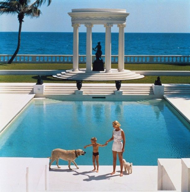 'Nice Pool' Ctype print.  1955. American writer C.Z. Guest (Mrs F.C. Winston Guest, 1920 – 2003) and her son Alexander Michael Douglas Dudley Guest in front of their Grecian temple pool on the ocean-front estate, Villa Artemis, Palm Beach. Original Publication: A Wonderful Time – Slim Aarons (Photo by Slim Aarons) Various sizes and frames available order online from GALERIEPRINTS.com