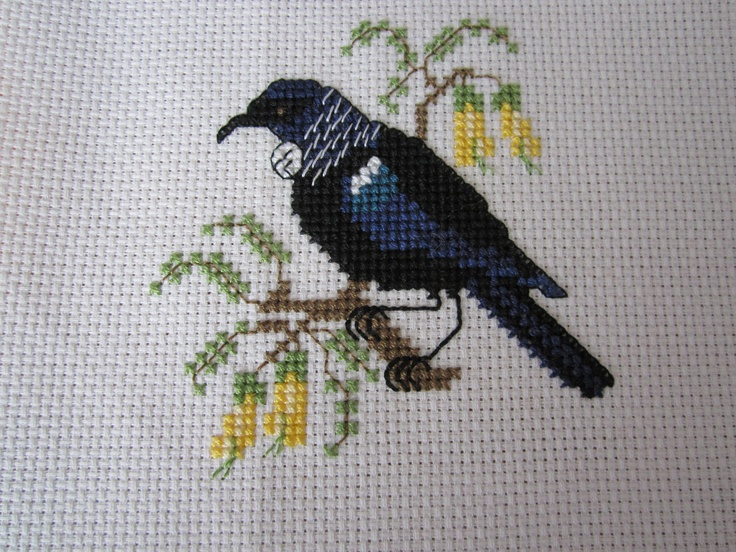 cross-stitch embroidery showing a NZ native bird, te Tui )Parson Bird)