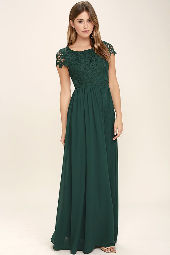Celebrate your timeless beauty in The Greatest Forest Green Lace Maxi Dress! Stunning floral lace overlays a princess seamed bodice with sheer cap sleeves and a backless design (with top button). A cascading, full maxi skirt flows from a fitted waist. Hidden back zipper/hook clasp.