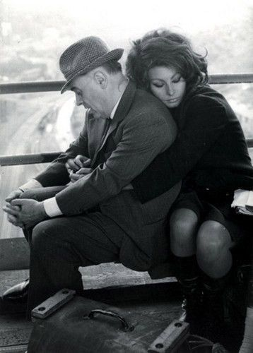 Sophia Loren with her arm around her husband, Carlo Ponti. She is such a gorgeous woman and they look so very in love.
