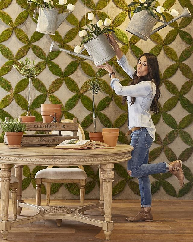 One of my favorite things in the Magnolia Home showroom is this fun moss wall we made and this amazing oval carved table that is available to retailers for my Spring launch at High Point Market next week. #magnoliahome @highpointmarket