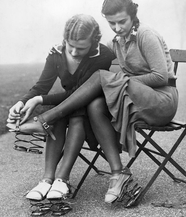 Ladies putting on shoes with springs, 1935.