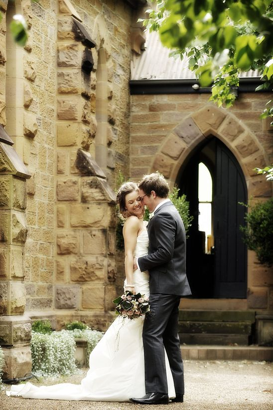 Hunter Valley Wedding Photographer from Impact Images captures this lovely photo of the bride and groom outside one of Hunter Valley's churches | For more photos, check out www.impact-images.com.au