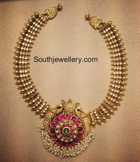 Traditional Gold Necklace with Peacock Pendant