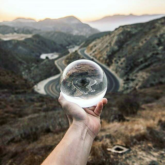 A whole world captured within a lensball! 🌎🔮 Insane photo by @chris_pavloff