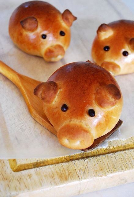 Piggy sausage rolls! Cover the meat with pastry dough to make a ball. Then add extra bits to make the pig ears, nose and tail. Bake with tooth picks in the dough so their nostrils don't close up while they bake. Then add some pepper balls for they eyes - so cute!