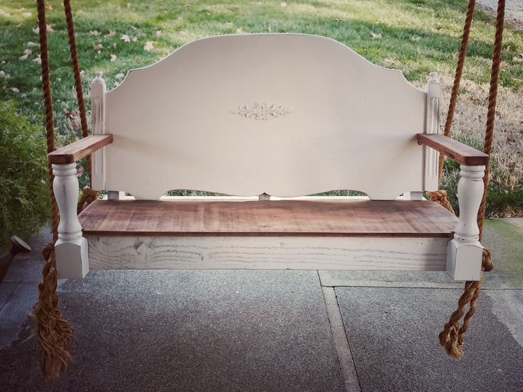 Repurposed porch Swing Made from a vintage headboard, seat from old barn wood, arms from a vintage leg cut in half. Hung with chunky rope we picked up at a garage sale.