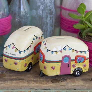 """See The World Camper Bank The Camper Bank is a great way to save for your next adventure. Fun camper-shaped ceramic bank with coin slot on top, """"See The World"""" on the back, and removable rubber stopper on the bottom. Great gift for travel lovers! Ceramic 3 1/4"""" H x 4 1/3"""" W x 2 1/2"""" D"""