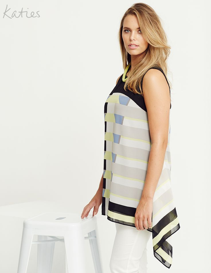 GRAPHIC TUNIC / With a clean graphic print, modern asymmetrical drape hemline and a pop of citrus, this season's must-have tunic is transformed into a bold statement piece.