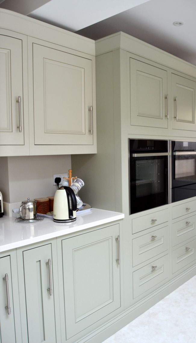 Vanilla quartz worktops complement the flint grey and almond cabinetry creating a very restful and inviting colour palette.