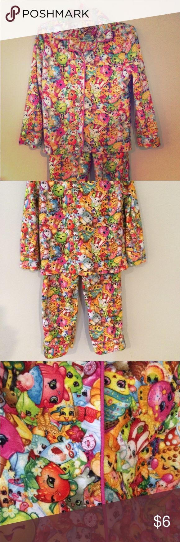 Shopkins Pajamas Long sleeved shirt and pants Shopkins pajamas. Shirt is collared and buttons up the front with pink sparkly buttons. Elastic waistband. Pajamas Pajama Sets