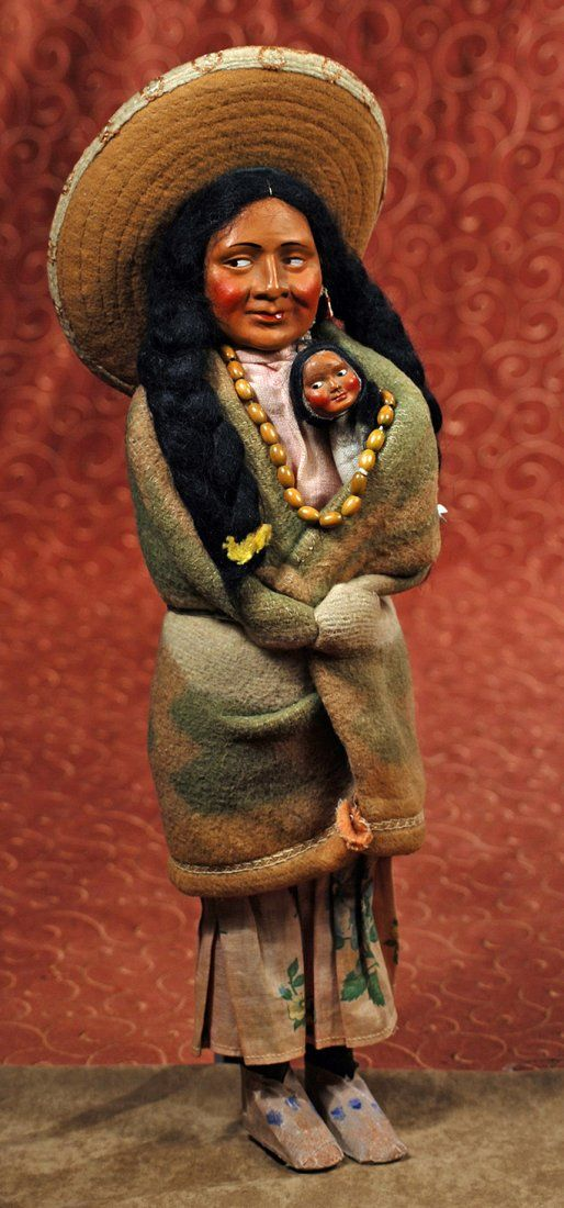 "ORIGINAL NATIVE AMERICAN ""SKOOKUM"" DOLL. 16 ½"". Depicting mother with papoose."