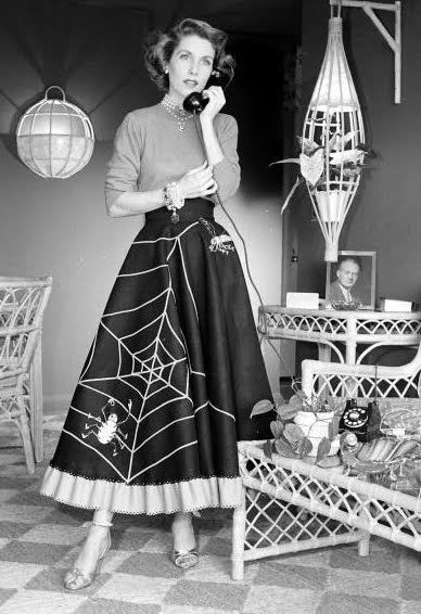 {Vintage photo of a beautifully stylish 1950s woman sporting a spider web adorned skirt via Starlet Showcase.}
