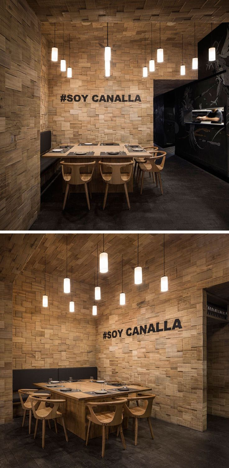 To contribute to this modern restaurant's informal concept, the walls are covered in wood shingles and the flooring has been created using small tiles in natural stone, similar to a cobblestone street.