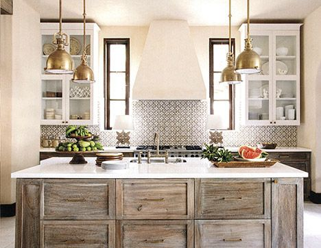 I'm completely enamored with the idea of a graphic tile on the wall with the stove and then a coordinating, more subdues subway tile for the rest!  Design Crush: Beth Webb