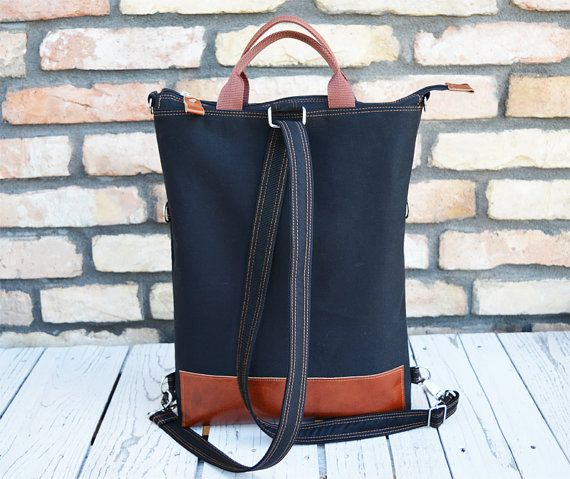 This black canvas and grey leather messenger tote bag is a simple and chic looking fashion accessory you can carry anywhere. I make the durable leather and canvas tote bag with adjustable and detachable shoulder strap. Perfect laptop carrier for husband and wife. The interior is big enough, it fits, folders, files, books. Ideally spacious to fit all your necessary things. It is a 100% handmade product.  This item is simple, stylish, modern, pretty, beautiful. Unique and special.  Details…