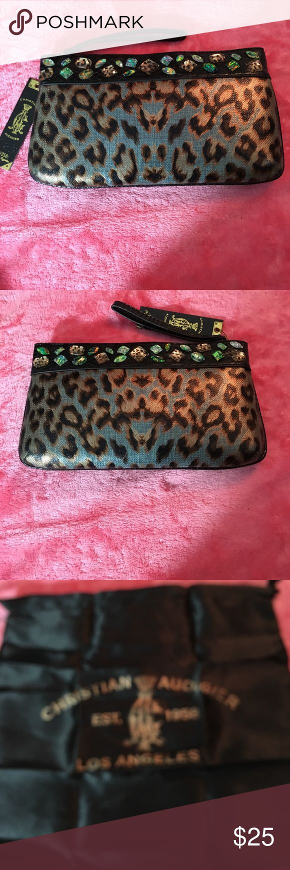 """Christian Audigier Animal Print Clutch with Stones Christian Audigier clutch bag with detachable wrist strap and magnetic closure.  Linen look turquoise background with gold, bronze & black animal print design.  Multi color stones encircle the top of the clutch. 11"""" wide 6 1/2"""" high.  Dust cover with drawstring included. Christian Audigier Bags Clutches & Wristlets"""
