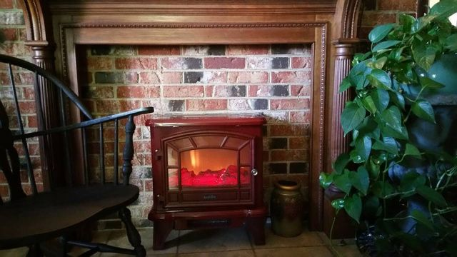 combine a freestanding stove with a mantel and you have an instant fireplace anywhere