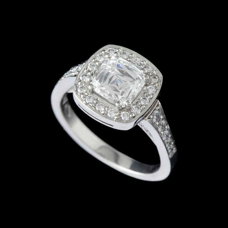 Cushion diamond cluster ring set in platinum.
