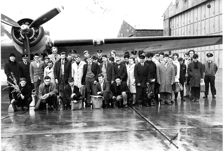 Jean Vanier and friends are looking very posh in front of an airplane at the military airport in 1966.