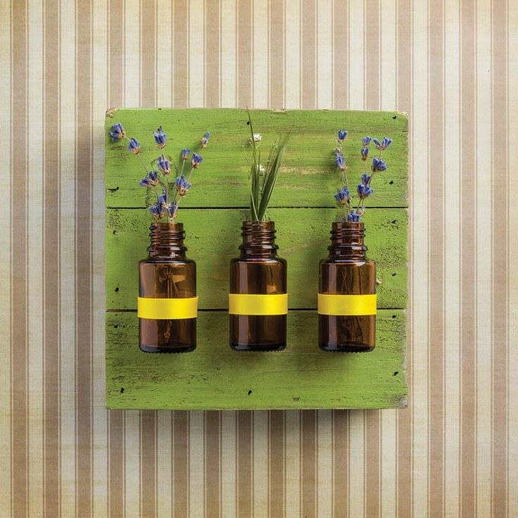 Have too many empty essential oil bottles? Turn them into art instead.