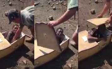 DISTURBING: Video Surfaces Showing White Settlers Forcing African Boy Into Coffin