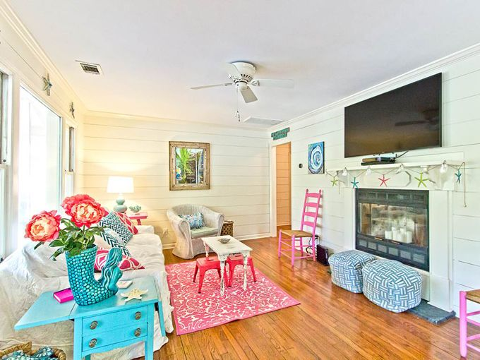 It's Tybee Time! The Salty Mermaid Cottage on Tybee Island, Georgia is an authentic 1940's cottage full of coastal charm and cheery color! You can tell the owners really had a lot of fun deco…