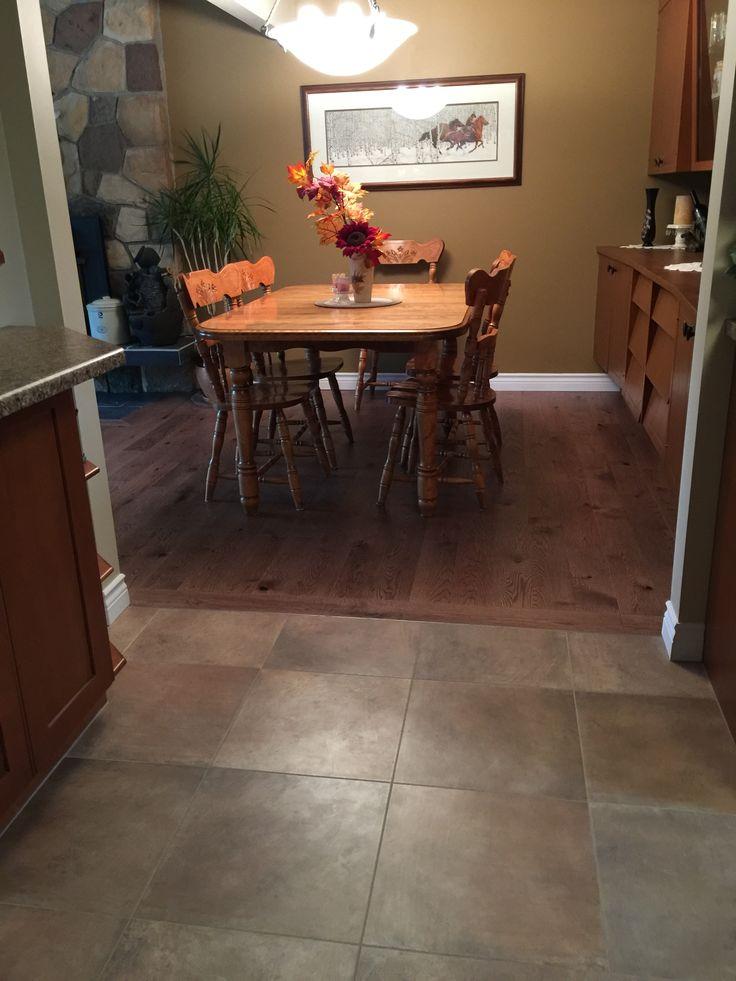 The concretesque tiles compliment the rustic hardwood...Gorgeous!