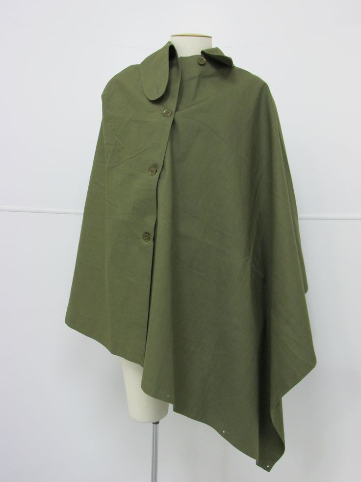 Khaki rain cape, circa 1950s. From the collection of the Air Force Museum of New Zealand.