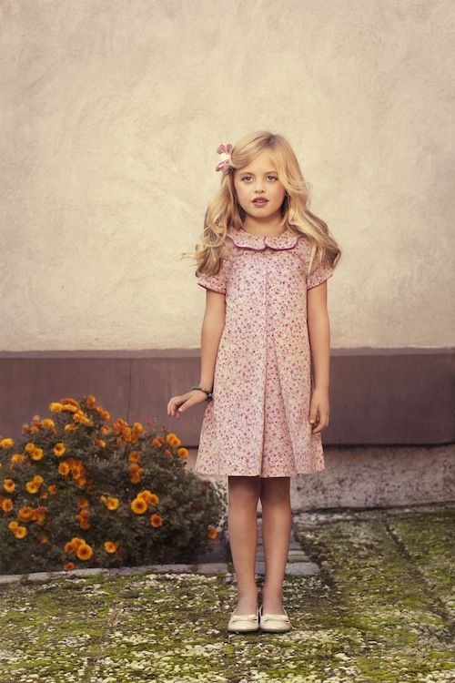 Cutest Spring Dresses at Mimivail - this girl loos way too old for her age but I love the dress!: