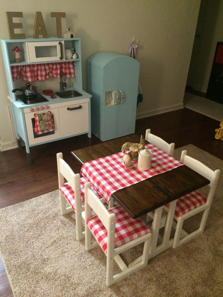 IKEA play kitchen hack. Painted the kitchen and fridge with Waverly chalk paint in Pool, added new hardware from hobby lobby, made a valance and hand towels for the kitchen, recovered the chairs, made a runner, painted the legs and chairs with rustoleum heirloom white spray paint, stained the top with Minwax espresso (sealed with high gloss clear spray paint), sealed the rest with matte clear enamel spray paint.