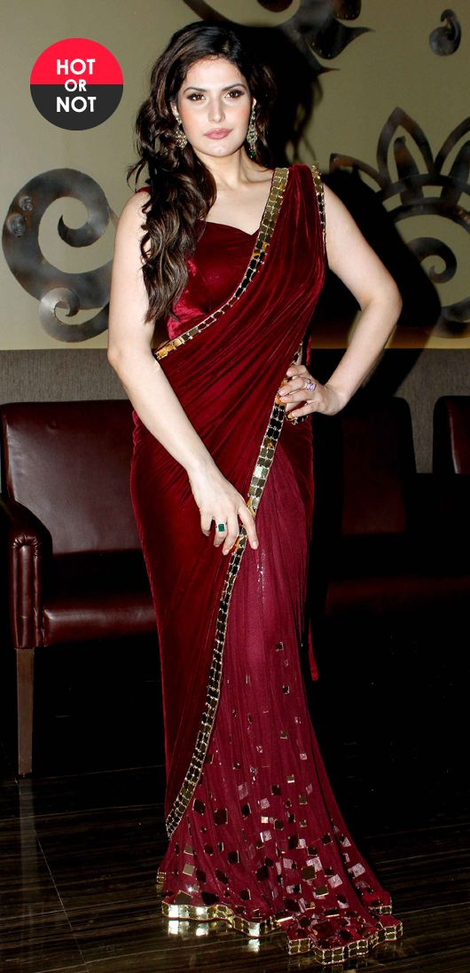 Zarine Khan recently launched a new line of jewellery along with designer Archana Kocchar. At the event Zarine wore one of Archana's designs – a velvet and chiffon maroon sari with gold work