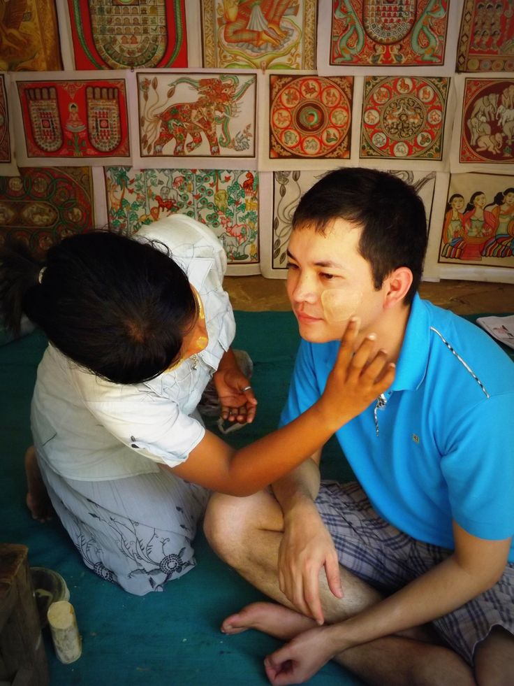 As the midday sun rose, I hid under the shelter of a market stall and watched a friend have his face painted with thanaka. This traditional yellow paste is said to cool the skin and protect against sun damage. Bagan, Myanmar (2014)