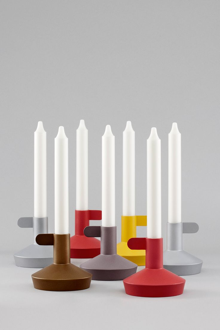 The Flag candleholder from Normann Copenhagen is a fun and festive interpretation of the classic chamber candlestick. The Flag Candleholder comes in 5 great colors: red, brown, yellow, silver and gold.  Dimensions: Height: 9 cm x