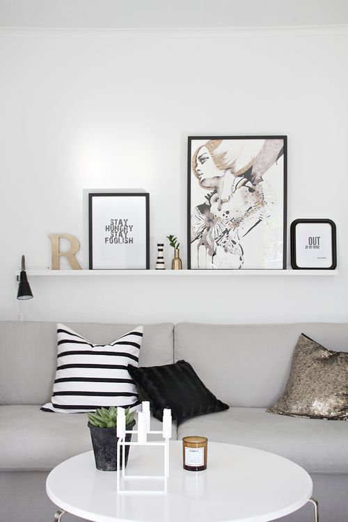 my perfect palette- graphic but simple black and white pillow, sequins, soft grey, and stark white.  LOVE