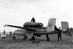 """Heinkel He-162- 120086 Many of Germany's captured new and experimental aircraft were displayed in an exhibition as part of London's Thanksgiving week on September 14, 1945. Among the aircraft are a number of jet and rocket propelled planes. Here, a side view of the Heinkel He-162 """"Volksjaeger"""", propelled by a turbo-jet unit mounted above the fuselage, in Hyde park, in London."""