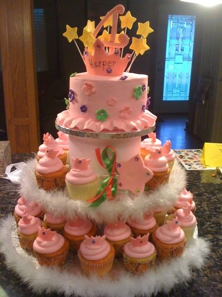 Princess cup cakes - Princess topper with cupcakes.  Fondant cutouts for each cupcake.