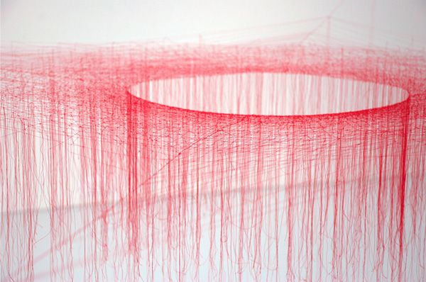 AKIKO IKEUCHI, SILK VORTEX: vor­tices of silk, tying hun­dreds of small knots in coloured thread to form elab­o­rate gallery instal­la­tions. #akiko_ikeuchi #installation