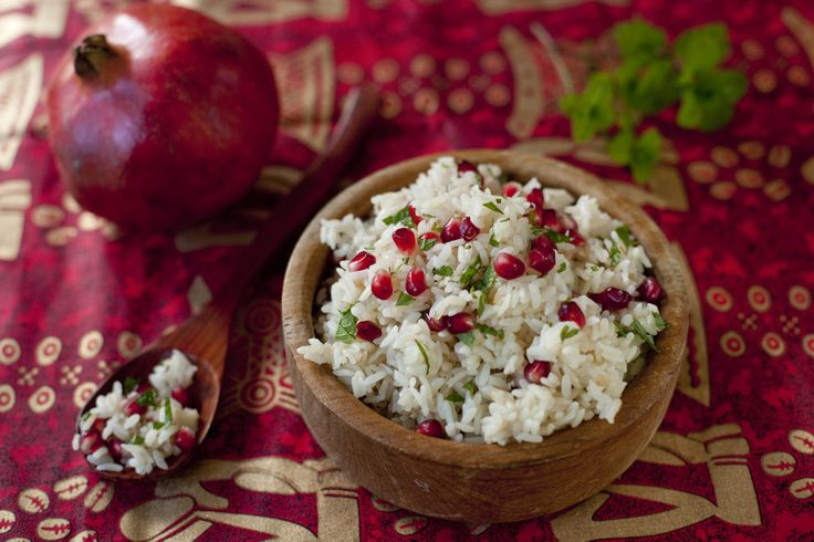 Rice is cooked with a cinnamon stick, then tossed with saffron, pomegrante seeds, and fresh mint for this aromatic pomegranate saffron rice recipe. From EatingRichly.com