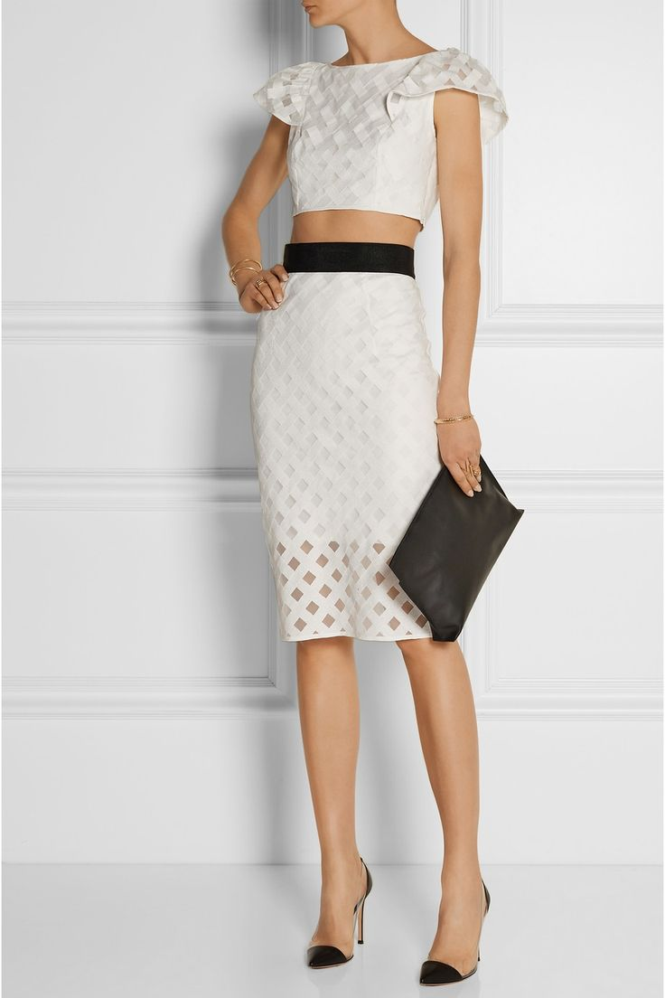 Milly top and skirt, Gianvito Rossi shoes, Loewe clutch, Anndra Neen cuff, and Jennifer Fisher ring.