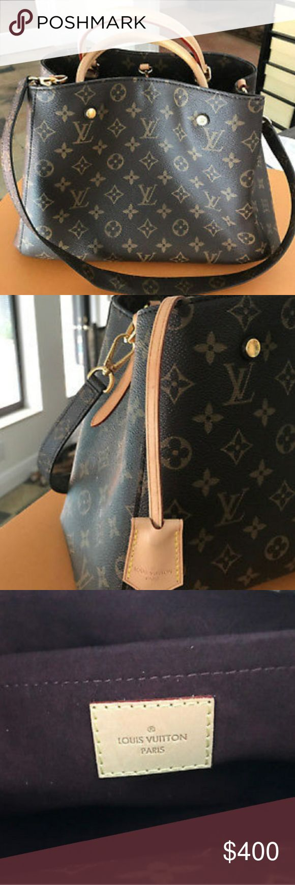 Louis Vuitton MM Canvas Monogram Leather Bag IN GREAT CONDITION , USED ONCE. HAVE ALL THE ORIGINAL TAGS, BOXES, DUST BAG AND RECEIPT.  PURCHASED AS A CHRISTMAS PRESENT LAST YEAR.  PRISTINE CONDITION HAS SAT IN IT'S ORIGINAL BOX ALL YEAR. SMOKE FREE HOME.. SERIAL NUMBER -SD4176 Louis Vuitton Bags Shoulder Bags