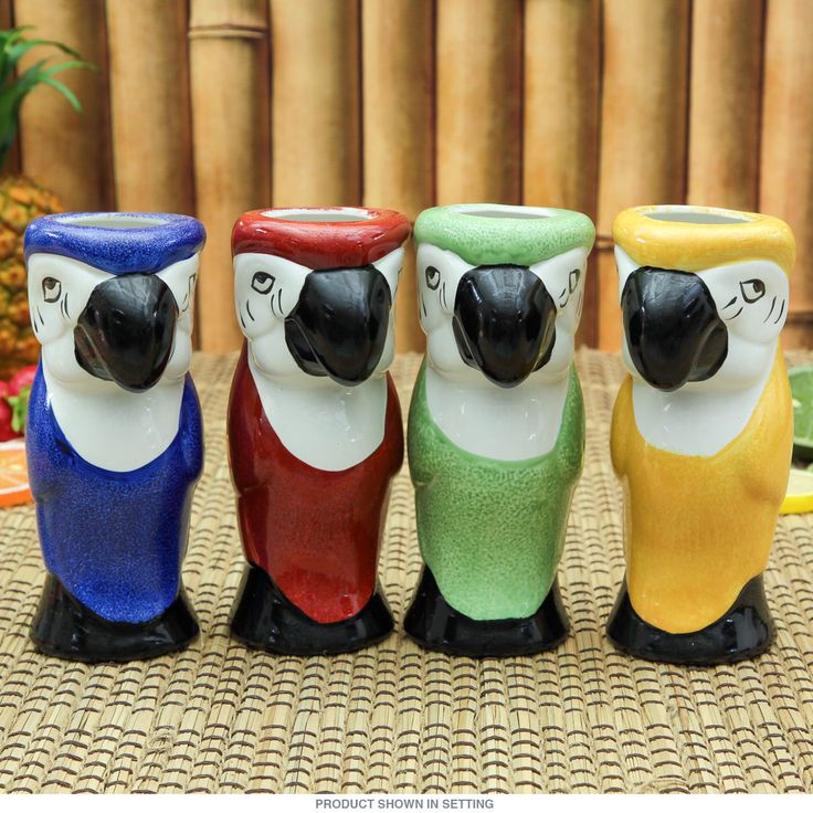 These 4 ceramic tiki mugs are brimming with retro 50s Hawaiian style. Dishwasher safe and sporing a glossy finish, these restaurant-quality Hawaiian cups are just what you need to serve up tropical drinks at your next Polynesian party. Fun tiki barware with a parrot theme.